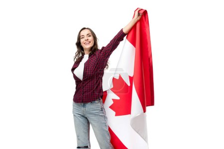 happy woman in casual clothes holding canadian flag isolated on white