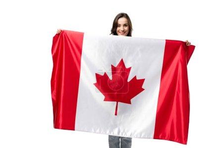 Photo pour Femme souriante tenant le drapeau canadien isolé sur blanc - image libre de droit