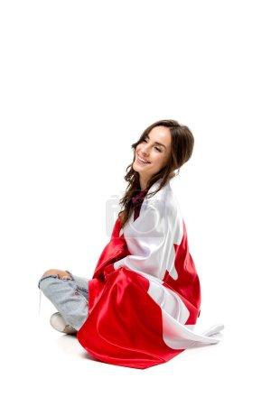 Photo pour Belle femme heureuse couverte de drapeau canadien isolé sur blanc - image libre de droit