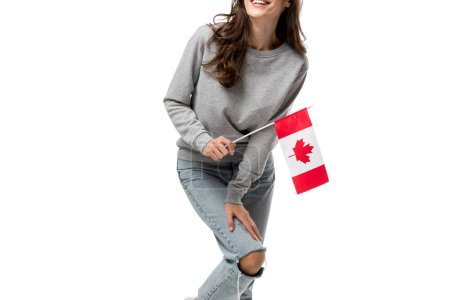 cropped view of woman in grey casual clothes holding canadian flag isolated on white
