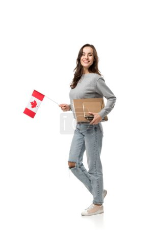 Photo for Beautiful smiling female student holding canadian flag and notebooks isolated on white - Royalty Free Image