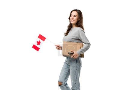 Photo pour Étudiante souriante tenant le drapeau canadien et cahiers isolés sur blanc - image libre de droit