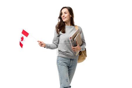 Photo pour Étudiante souriante avec sac à dos et cahiers tenant le drapeau canadien isolé sur blanc - image libre de droit