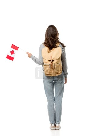 back view of female student with canadian flag and backpack isolated on white
