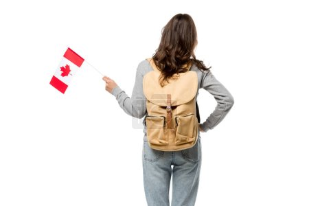 back view of female student with canadian flag and hand on hip isolated on white