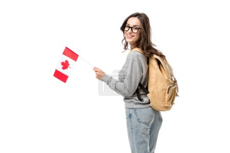 female student with canadian flag and backpack looking at camera isolated on white
