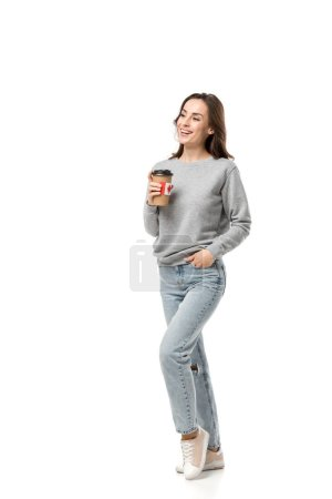 Photo for Smiling woman holding coffee cup with canadian flag sticker isolated on white - Royalty Free Image