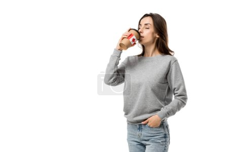 woman drinking coffee from cup with canadian flag sticker isolated on white