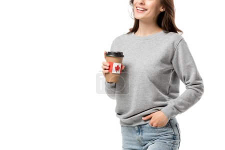 cropped view of woman holding coffee cup with canadian flag sticker isolated on white