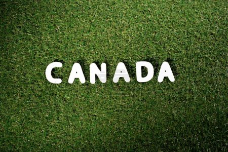 top view of word 'Canada' on green grass background