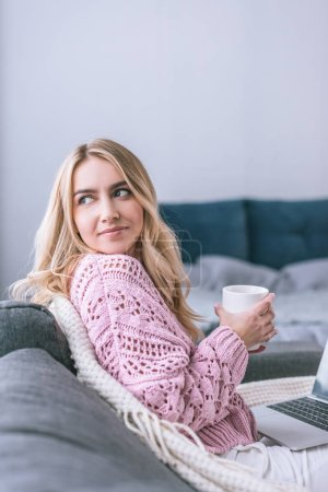 Photo for Attractive woman holding cup with drink at home - Royalty Free Image