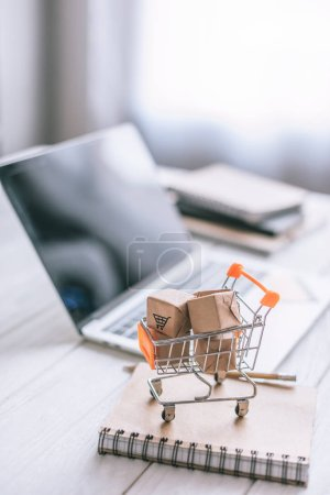 selective focus of decorative packages in toy cart on wooden desk