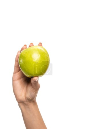 close-up partial view of young african american woman holding fresh green apple isolated on white