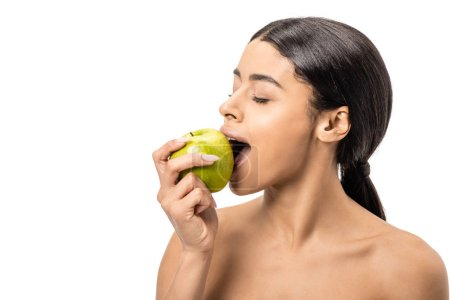 beautiful young naked african american woman biting fresh apple isolated on white