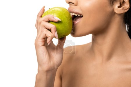 cropped shot of young naked african american woman biting fresh apple isolated on white