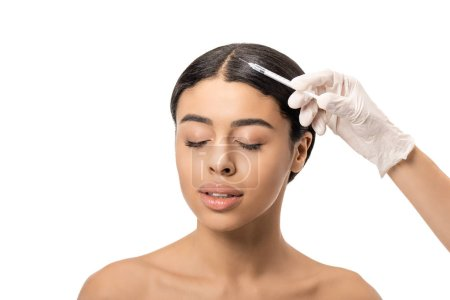 Photo for Cropped shot of cosmetologist in latex glove giving beauty injection to young african american woman with closed eyes isolated on white - Royalty Free Image