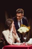 Постер мужчина дарил цветы удивлен