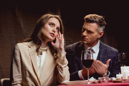 couple quarreling while having romantic date in restaurant