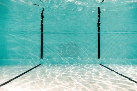 underwater in empty swimming pool with blue water