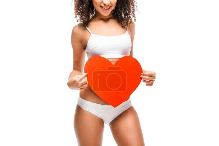 cropped view of african american girl in underwear holding heart shaped card isolated on white