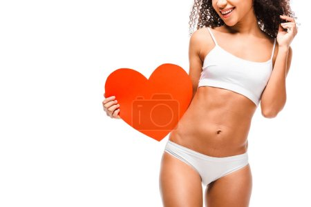Photo for African american girl in underwear holding heart shaped card isolated on white - Royalty Free Image