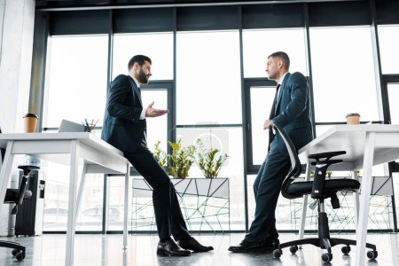 Photo for Businessmen in formal wear having discussion in modern office - Royalty Free Image