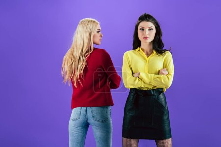 Photo for Confident women posing with crossed arms on purple background - Royalty Free Image