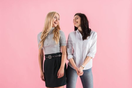 Photo for Gorgeous young women laughing isolated on pink - Royalty Free Image