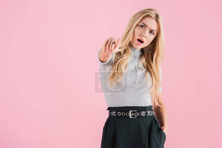 Photo for Shocked young woman pointing at you, isolated on pink - Royalty Free Image