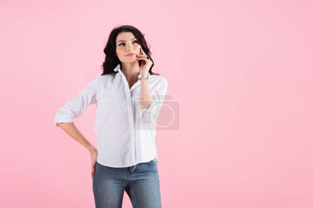 Photo for Beautiful dreamy woman thinking and looking up, isolated on pink - Royalty Free Image