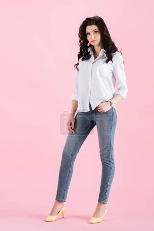 Photo for Attractive brunette girl posing in casual clothing, isolated on pink - Royalty Free Image