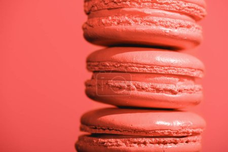 Photo for Close up of sweet macaroons on Living coral background. Pantone color of the year 2019 concept - Royalty Free Image
