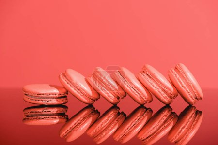 Photo for Living coral macaroons with reflection. Pantone color of the year 2019 concept - Royalty Free Image