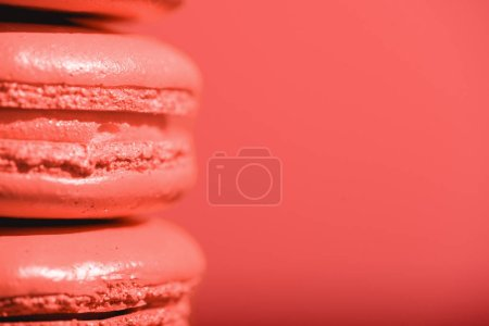 Photo for Close up of Living coral macaroons on red background. Pantone color of the year 2019 concept - Royalty Free Image