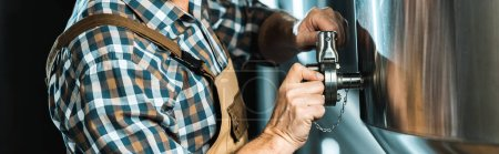 Photo for Cropped view of professional male brewer working with brewery equipment - Royalty Free Image