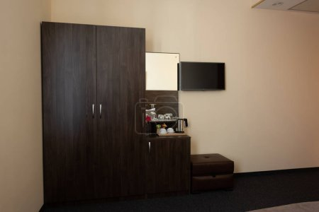 Photo for Hotel room interior with wardrobe and mirror - Royalty Free Image