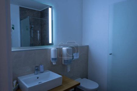 Photo for Bathroom interior with sink, toilet, and mirror - Royalty Free Image