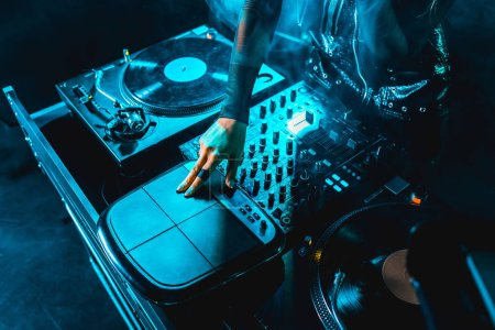 Photo for Cropped view of dj woman using dj equipment in nightclub - Royalty Free Image