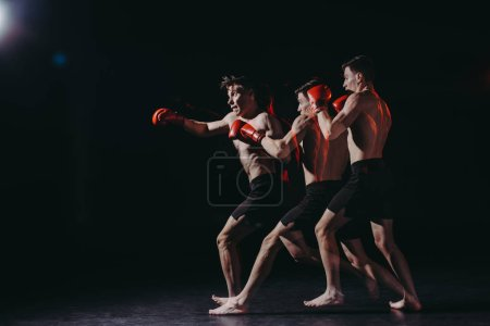 Photo for Sequence shot of handsome shirtless muscular boxer in boxing gloves doing punch - Royalty Free Image