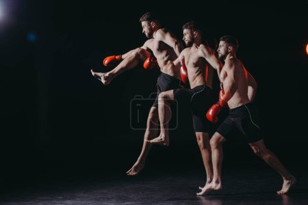 Photo for Multiple exposure of strong shirtless muscular mma fighter in boxing gloves doing kick in jump - Royalty Free Image