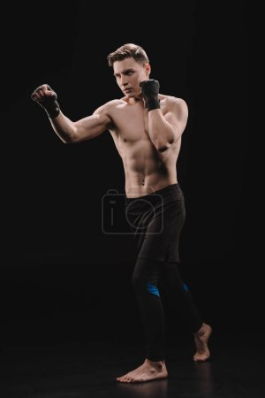 strong barefoot muscular sportsman in