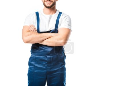Photo for Cropped view of mover in uniform with arms crossed isolated on white with copy space - Royalty Free Image