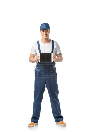 Photo for Smiling mover looking at camera and presenting digital tablet with blank screen isolated on white - Royalty Free Image