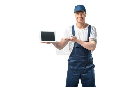 Photo for Mover looking at camera and presenting digital tablet with blank screen isolated on white - Royalty Free Image