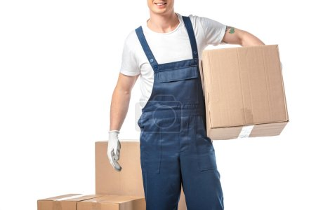 Photo for Partial view of mover in uniform carrying cardboard box isolated on white with copy space - Royalty Free Image