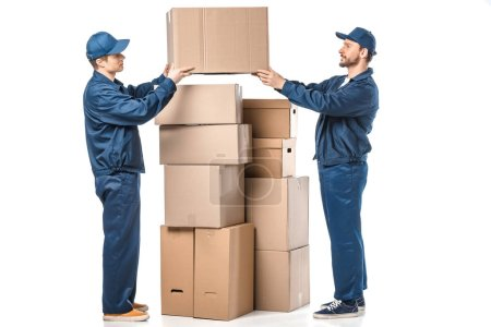 Photo for Two movers in uniform holding cardboard box on white - Royalty Free Image