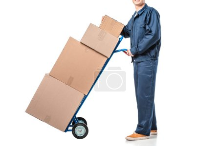Photo for Cropped view of mover in uniform transporting cardboard boxes on hand truck isolated on white - Royalty Free Image