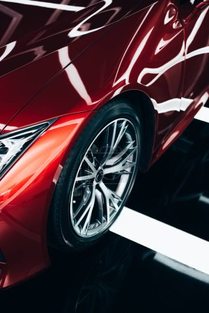 Photo for New shiny red automobile with metallic wheel in car showroom - Royalty Free Image