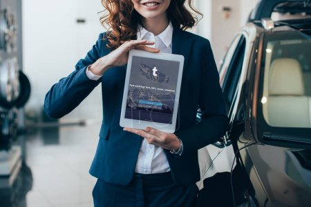 Photo for Partial view of businesswoman holding digital tablet with tumblr app on screen - Royalty Free Image