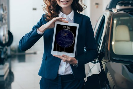 Photo for Partial view of businesswoman holding digital tablet with ipad lock on screen - Royalty Free Image